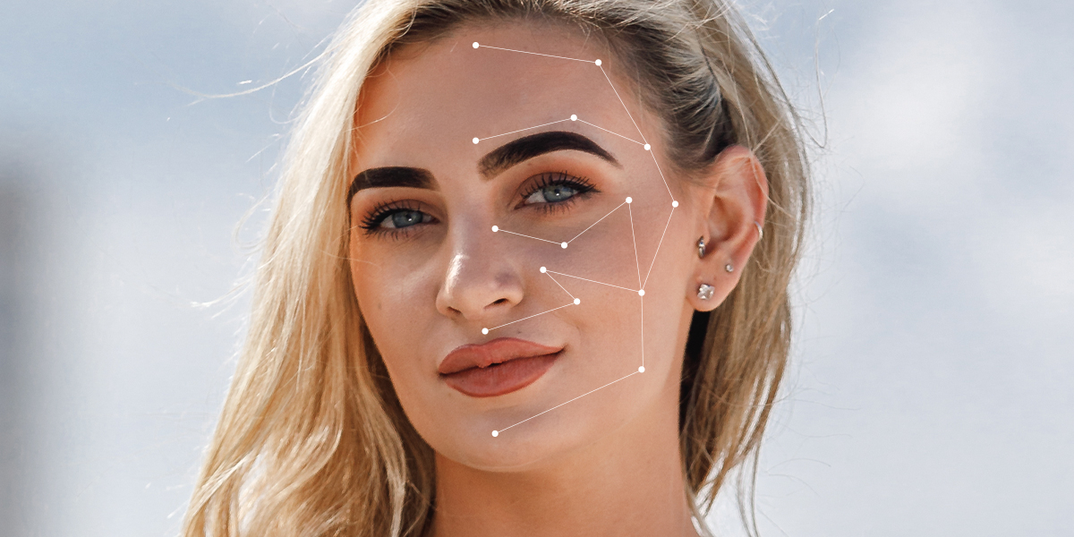 white woman cosmetic tattoo eyebrows lips freckles eyeliner beautiful blond hair