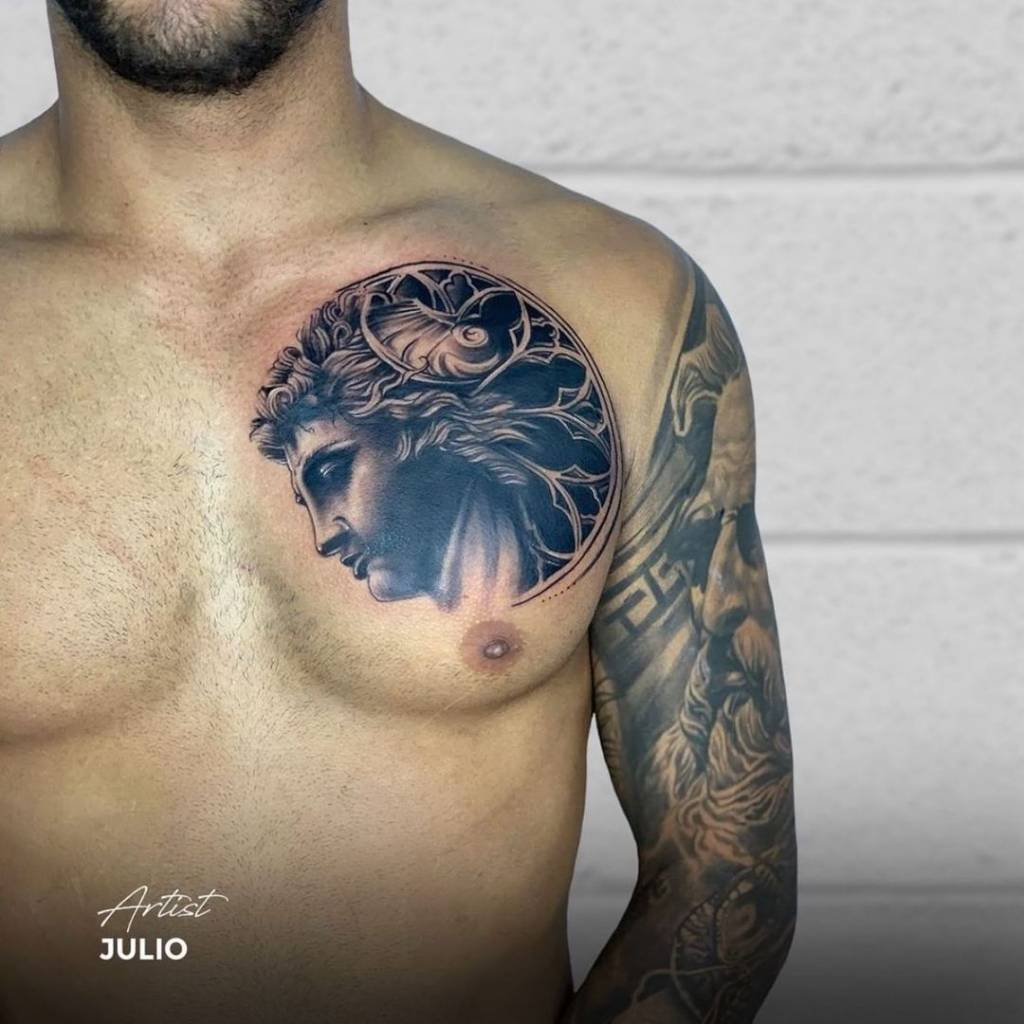 black and grey tattoo chest piece statue realism realistic face
