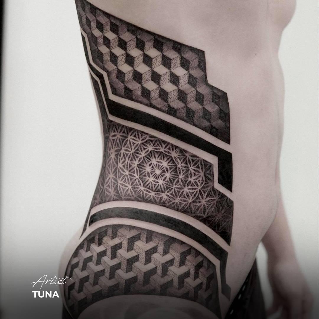 geometric tattoo black and grey ribs stomach squares optical illusion