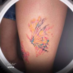 watercolour butterfly tattoo thigh