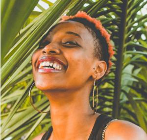 tragus piercing black woman smiling hoop earrings celebrity ink